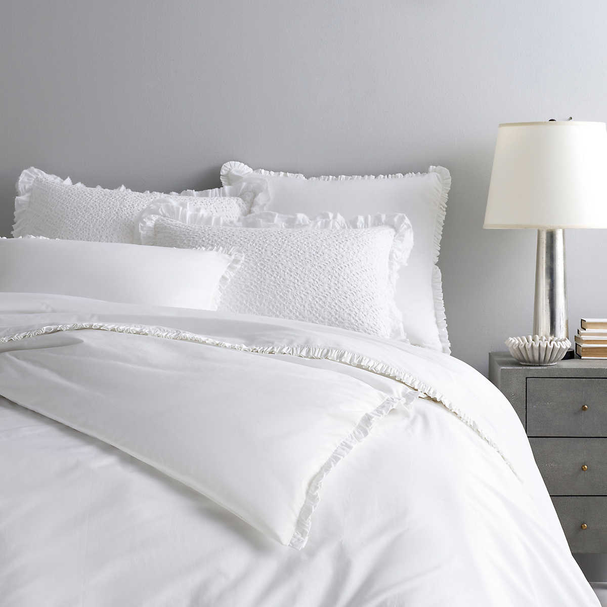 Discover our soft and luxurious ruched bedding. The Sutter White duvet set is lustrous ruched bedding made of thread-count % cotton sateen.